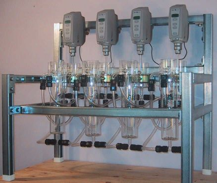 Laboratory or bench scale solvent extraction pilot plant with 4 mixer-settlers.